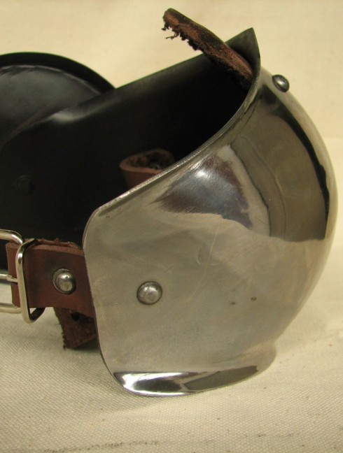 Forearms with elbow caps and round rondels Metal bracers, couters and full arms