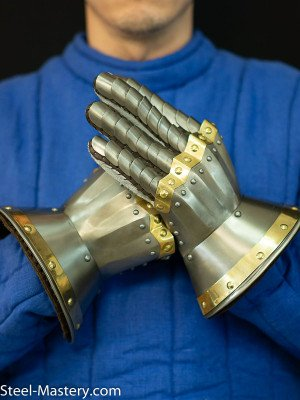Gauntlets dated 1410-1420  Metal fingered and mitten gauntlets