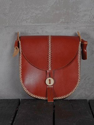 Leather bag with hand-made stitching
