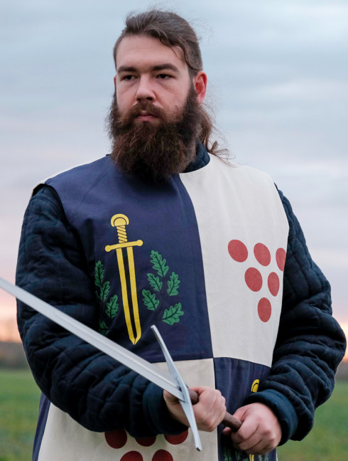 Tabard with silk-screening of scarlet dots, golden swords, and green oak leaves