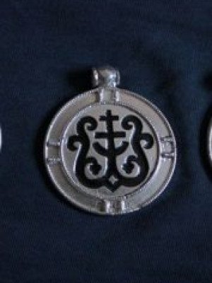 Pendant with a cross and heraldic ornaments