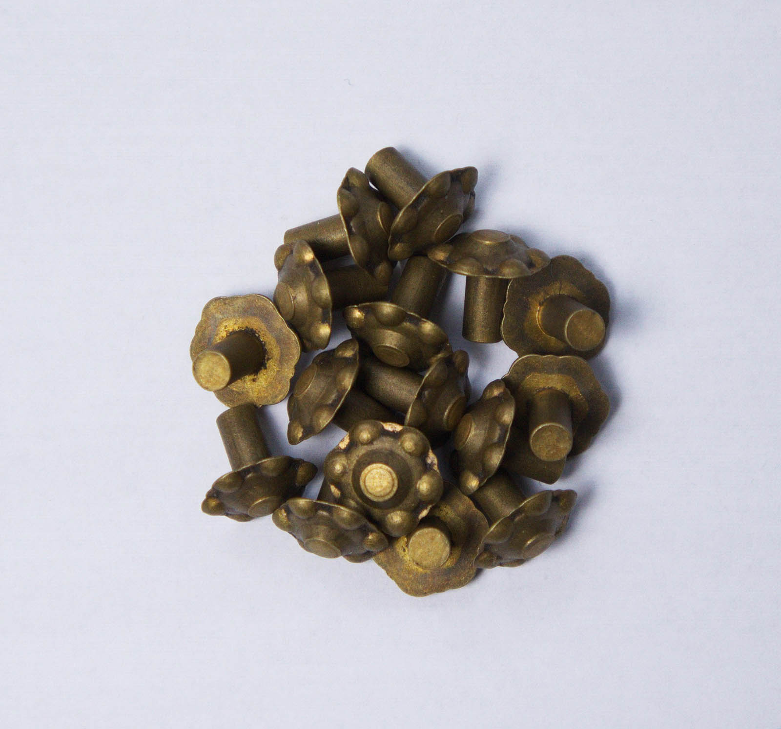 figured brass rivet